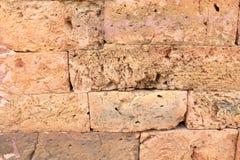 Orange Ziegelstein stellen Felsenwand her Lizenzfreie Stockfotos
