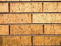 Orange Ziegelsteinhintergrund auf einem Gebäude Lizenzfreies Stockfoto