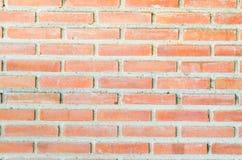 Orange Ziegelsteinwand Stockfotos