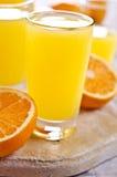 Orangeade dans un verre photos stock