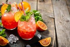 Orangeade ensanglantée et ingrédients photos libres de droits