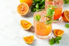 Orangeade ensanglantée et ingrédients image libre de droits