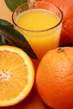 Orangejuice2. Orange juice and half orange Stock Photography