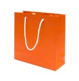 Orangen återanvänder den paper shoppingpåsen Royaltyfri Foto