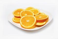 Orangen auf Platte Stockbild