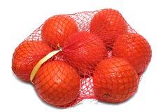 Orangen in der Verpackung Lizenzfreie Stockfotos