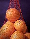 Orangen in einem Beutel Stockbild