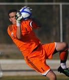 orangen för den bollKanada vårdaren sparar fotboll royaltyfria bilder
