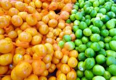 Orangen und Kalke Stockfotografie