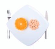 Orangen- und Vitaminpille Lizenzfreie Stockfotos