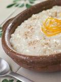 Orangen-und Zimt-Reis-Pudding Stockbild