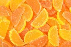 Orangen- und Zitronensüßigkeitsscheiben als Hintergrund Stockbilder