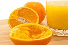 Orangensaft zusammengedrückt und vollständig Lizenzfreies Stockbild