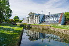 Orangery of Palmse manor and reflection in water canal Stock Photos