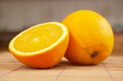 Oranges. Fresh and juicy oranges on the table Royalty Free Stock Images