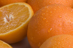Oranges. Close up of juicy oranges that have been halved Stock Photos