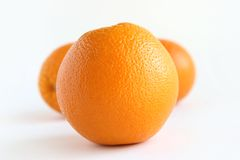 Oranges. Three oranges over white stock photography
