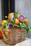 Oranges. Wicker basket with blood Sicilian oranges (tarocchi)  on a table of a street peddler Royalty Free Stock Images