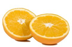 Oranges. An orange in two halves Royalty Free Stock Images
