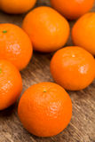 Oranges. On a wooden background royalty free stock image