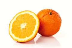 Oranges. Two fresh oranges isolated on white Stock Image