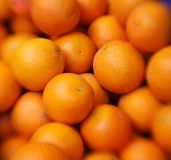 Oranges. Fresh oranges background. Defocused effect Royalty Free Stock Photography
