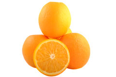 Oranges. Photogograph of oranges one cut in half. taken i  studio and isolated on white Royalty Free Stock Photos