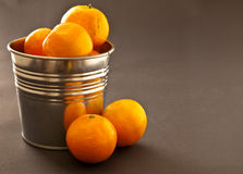 Oranges. Fresh oranges in a metal tin Royalty Free Stock Images