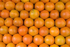 Oranges. Pile of oranges on the market as a background stock image