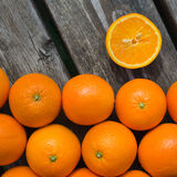 Oranges. A group of fresh oranges on a wooden table Royalty Free Stock Image