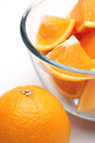 Oranges. Sliced oranges on a white background Stock Image