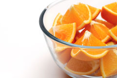 Oranges. Sliced oranges on a white background Stock Images