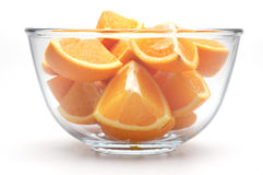 Oranges. Sliced oranges in a glass bowl on a white background Stock Photo