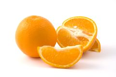 Oranges. Several sliced juicy oranges on white background Stock Photos