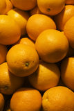 Oranges. Mature oranges arranged in bulk Stock Photos