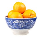 Oranges in an ancient hand-painted bowl Stock Image