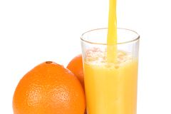 Oranges And Half Juice In Glass Stock Images
