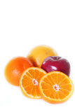 Oranges, apple and grapefruit Royalty Free Stock Image