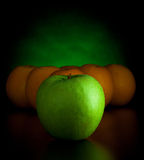 Oranges and apple like billiard balls Royalty Free Stock Images