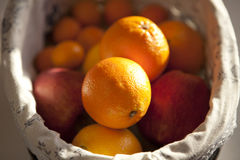 Oranges and apples. In bowl royalty free stock photos