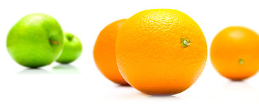 Oranges and apples. On white Stock Image