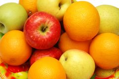 Oranges and apples assorted in. Oranges  and apples assorted in the tray Royalty Free Stock Photo