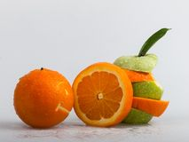 Oranges and Apples cool. The combination of a smiling orange, and beat up pieces of apples and oranges Royalty Free Stock Photo
