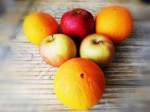 Oranges and apples royalty free stock photos