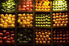 Oranges, Apples, Peppers. Fruits and vegetables stacked up vertically in a matrix at a night market in Dubai Stock Photo