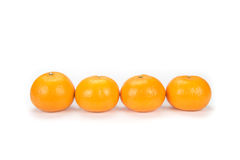 Oranges arranged to symbolize teamwork or unity. Isolated on white background royalty free stock photography