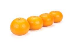 Oranges arranged to symbolize teamwork or unity. Isolated on white background royalty free stock photos