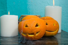 Oranges avec les visages découpés images libres de droits
