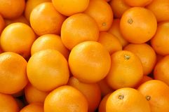 Oranges background. Overlapping Fresh oranges background as seen in a fruit stall Royalty Free Stock Photography