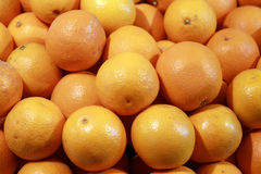 Oranges Background. A background of a heap of fresh and ripe oranges Royalty Free Stock Photo